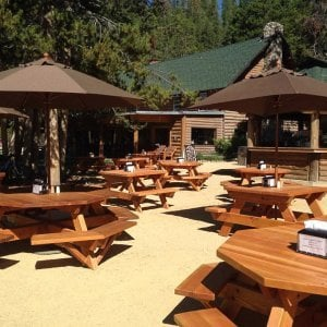 Octagonal Picnic Tables (Options: 6' Diameter Tabletop, Attached Benches, Douglas-fir, Standard Tabletop, Rounded Corners, Umbrella Hole, Transparent Premium Sealant). Forever Picnic Tables Shown in Background.  Photo Courtesy of Jeff C. of Stanley, Idaho.