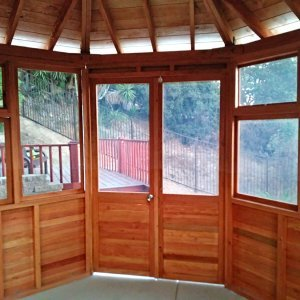"Octagonal Sunroom Gazebo (Options: 12' Diameter, No Deck, Douglas-fir, 36"" H Siding Below Windows, 4 Window Panels & Solid Panels, 2 Sets of Doors, Transparent Premium Sealant). Photo Courtesy of Y. Fang of Diamond Bar, CA."