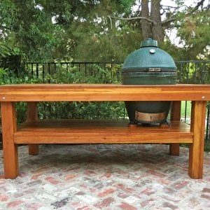 """The Ultimate BBQ Table (Options: 6' L, 34 1/2"""" W, Mosaic Eco-Wood, Two Shelves, Squared Corners, 32""""H, 21 1/2-inch Grill Opening, 16-inch Grill Support Shelf Height, Transparent Premium Sealant). Legs aligned to tabletop by custom request. Photo Courtesy of Christopher Barty of Irvine, CA."""