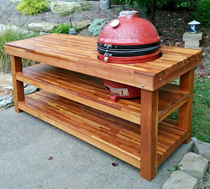 """The Ultimate BBQ Table (Options: 7' L, 31 1/2"""" W, Mosaic Eco-Wood, Two Shelves, Slightly Rounded Corners, 36"""" H, 22 1/2-inch Grill Opening, 21-inch Grill Support Shelf Height, Transparent Premium Sealant). Legs aligned to tabletop by custom request. Photo Courtesy of R. Veseleny of Canonsburg, PA."""
