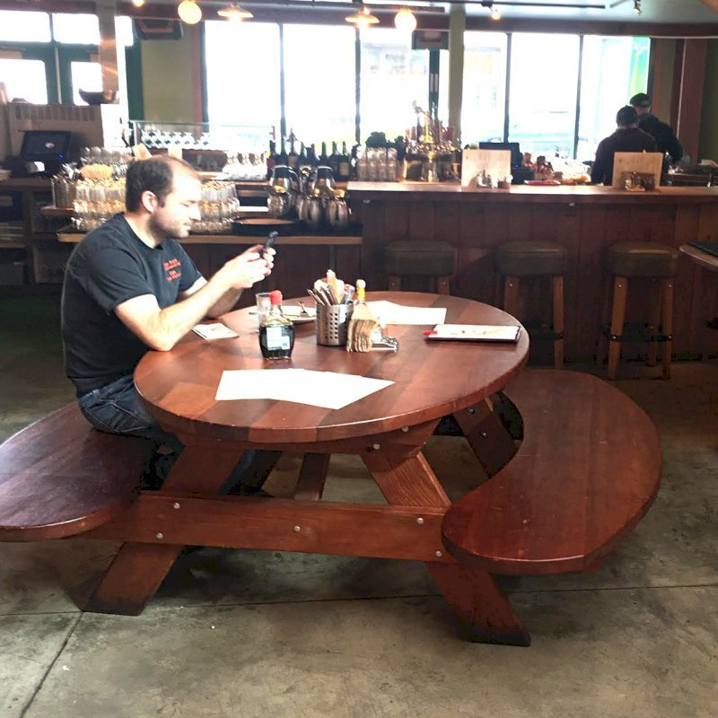 Custom Oval Picnic Table (Options: Old-Growth Redwood, Extra Wide Benches by Custom Request, Transparent Premium Sealant). Photo Courtesy of Chow's Restaurant in 3770 Piedmont Avenue, Oakland, CA.