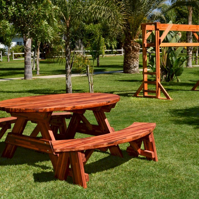 Oval Picnic Table (Options. Oval XL, Unattached Side Benches, Mosaic Eco-Wood, Standard Tabletop, Umbrella Hole, Transparent Premium Sealant). Photo also shows a Monkey Bar in background.