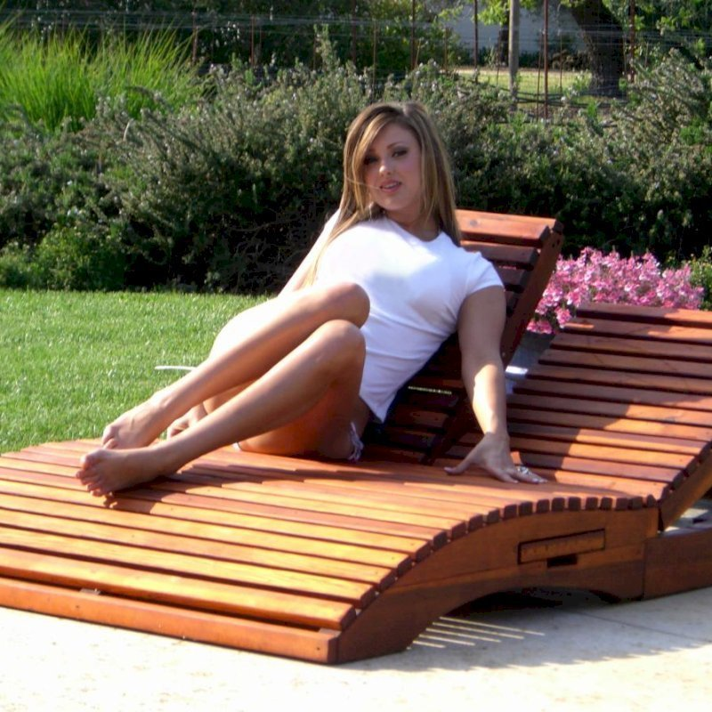 "Penny Wooden Sun Lounger (Options: Double, Mature Redwood, Snack Trays on Right Side, 13"" H, Wheels, No Cushion,Transparent Premium Sealant). Model: Ms. Hayley Hall of Sonoma County, CA."