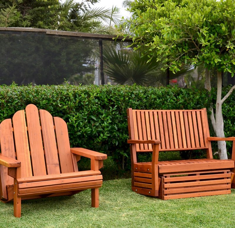 Porter Thayer Glider (Options: Double, Mature Redwood, No Cushion, Transparent Premium Sealant). Photo also shows an Adirondack chair Extra Wide.