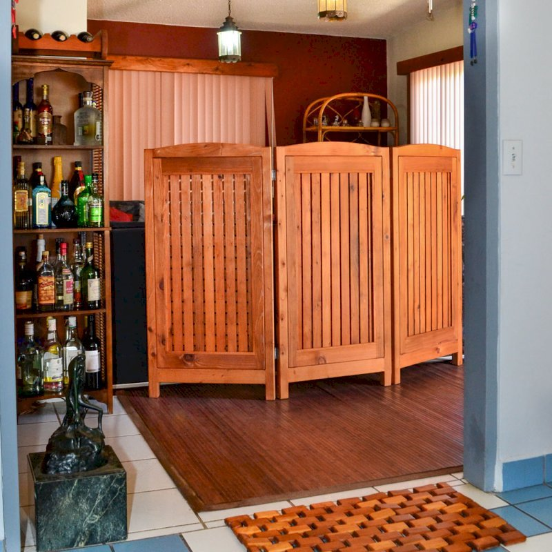 "Privacy Screen (Options: 3-Panel, 4' H, Mature Redwood, No View Window Opening, 3/8"" Openings, No Boots, Transparent Premium Sealant). Photo also shows a Flexible Wood Floor Mat and a Wine Rack."