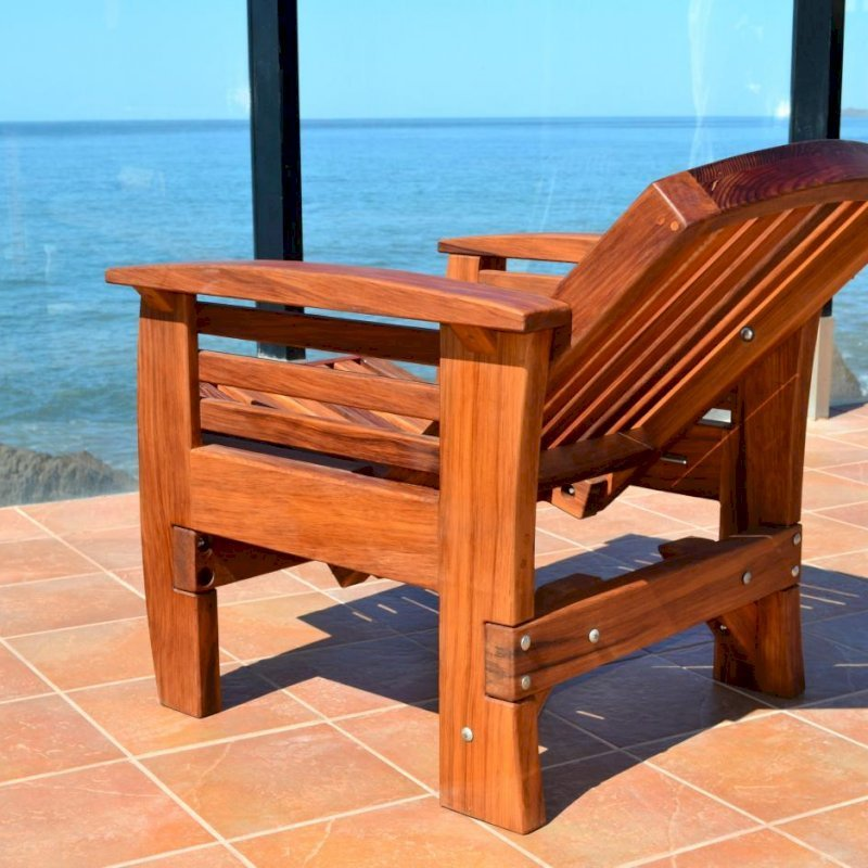 Reclining Easychair (Options: Mature Redwood, No Cushion, Transparent Premium Sealant). Photo shows fully reclined position.