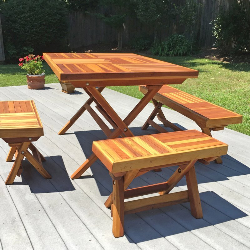 "Rectangular Folding Picnic Table (Options: 4 1/2' L, 35"" W, Folding Side Benches, Redwood, 1 Full Length Bench on one Side & 2 Half Length Benches on the Other Side by Custom Request, Standard Tabletop, Checkerboard Design Tabletop, Squared Corners, Umbrella Hole & Plug (1 5/8""), Transparent Premium Sealant). Photo Courtesy of A. Meyerson of Arnold, MD."