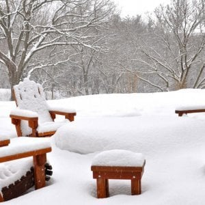 Set of 4 Adirondack Chairs and Square Side Table enjoying another snowy winter. (Options: Standard Size, Mature Redwood, Transparent Premium Sealant). Photo Courtesy of Mary Louise and Gerry Neugent of Des Moines, Iowa.