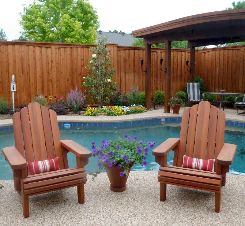 Adirondack Chairs (Options: Standard Size, Old-Growth Redwood, No Cushion, Transparent Premium Sealant). Vase Planters also in Old-Growth Redwood. Photo Courtesy of Ms. Cyndie Bertrand of Plano, TX.  Small back support cushions are a custom item.