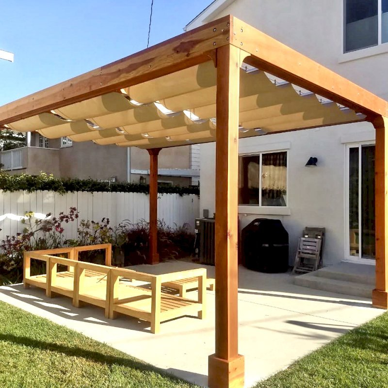 Retractable Shade Canopy Pergola Kit (Options: 18' L x 14' W, No Privacy Panel, California Redwood, 10' Post Height, 1 Electrical Wiring Trim, Post Anchor Kit for Concrete, No Post Decorative Trim, No Ceiling Fan Base, No Curtain Rods Transparent Premium Sealant). Photo Courtesy of D. Evans of Los Angeles, California.