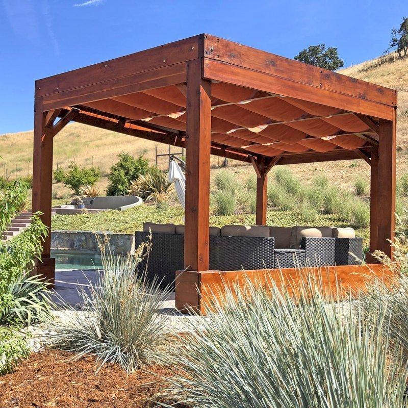 Custom Retractable Shade Canopy Pergola Kit (Options: 20' x 12', Mature Redwood, Posts Anchor Kit for Hurricane, Extra Thick Lumber by Custom Request, Transparent Premium Sealant). Retractable Shade Canopies Added by the Customer. Photo Courtesy of D. Ruprecht of Hollister, CA.