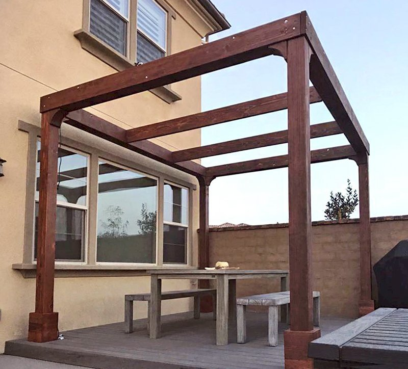 Retractable Shade Canopy Pergola Kit (Options: 14' L x 10' W, No Privacy Panel, California Redwood, 9ft Post Height, No Electrical Wiring Trim, Post Anchor Kit for Concrete, No Post Decorative Trim, No Ceiling Fan Base, No Curtain Rods, Coffee-Stain Premium Sealant). Photo Courtesy of D. Kim of Rancho Mission Vieja, CA.