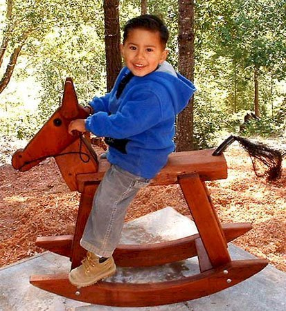 Rocking Horse - Note: Original smaller rocking horse design - classic photo from 2003 - we are sentimental and couldn't remove the photo...