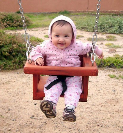 Toddler/Small Kid's Swing Seat  (Options: Mature Redwood, Transparent Premium Sealant).  This swing is being enjoyed by eight-month-old Norma Mia.  Toddler's swing seats are sized for kids up to age 5.