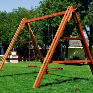 Rory's Giant Playground Swing Set (Options: Mature Redwood, Standard Swing Seats, Transparent Premium Sealant). Photo shows swing before diagonal braces installation.