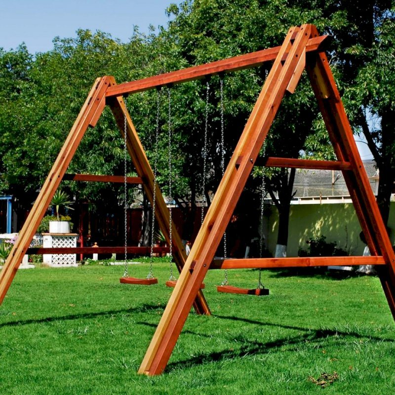 Rory's Giant Playground Swing Set (Options: Mature Redwood, Standard Swing Seats, Transparent Premium Sealant). Photo shows swing before diagonal braces installation.