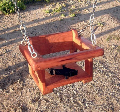 Small kids? Get a Toddler/Small Kid's Swing Seat instead of the Rory's swing seat (option available in the product configurator). Photo Shows Mature Redwood with Transparent Premium Sealant.  Safety strap and all the hardware comes with any swing set order