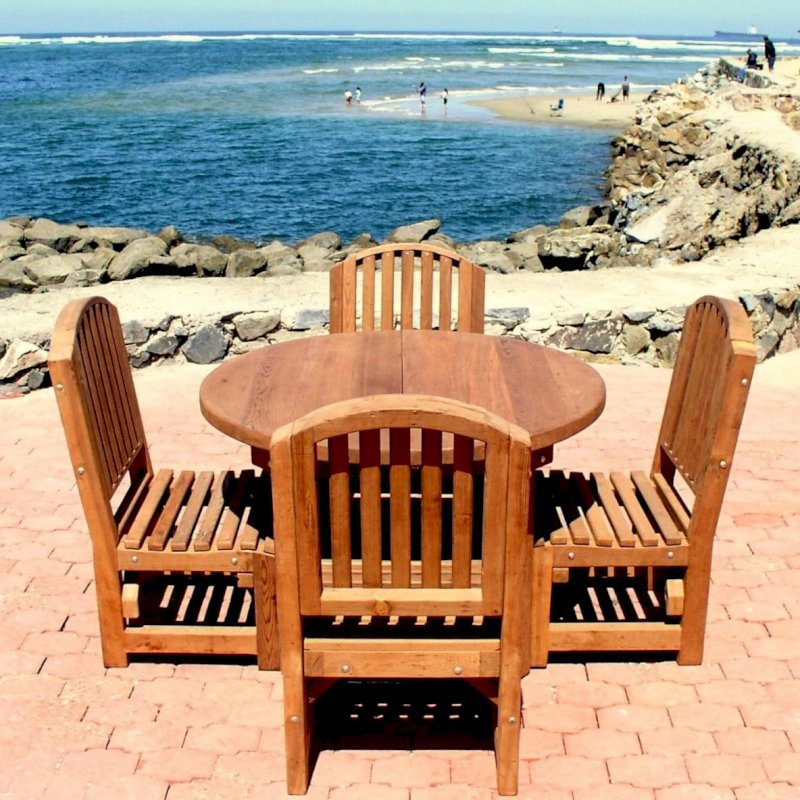 Round Patio Table (Options: 4', 4 Chairs, Mature Redwood, Luna Chairs, No Cushions, Side Chairs only (no arms), Seamless tabletop, No Lazy Susan, No Umbrella Hole, Transparent Premium Sealant).  Photo Courtesy of The Estero Beach Resort of Ensenada, Mexico.