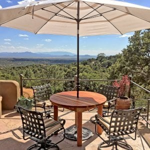 """Round Patio Table (Options: 4 ft, No Seating, Redwood, Standard Tabletop, No Lazy Susan, 1 5/8"""" Umbrella Hole, Transparent Premium Sealant). Phoro Courtesy of S. Strauch of Santa Fe, New Mexico."""
