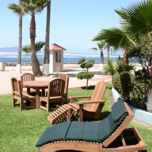 "Penny's Lounger, Round Patio Table with Luna Chairs & Adirondack Chair set. Note: the 7 section, 2"" thick cushion shown was a custom order. Photo Courtesy of Estero Beach Resort of Ensenada, Baja California Mexico."