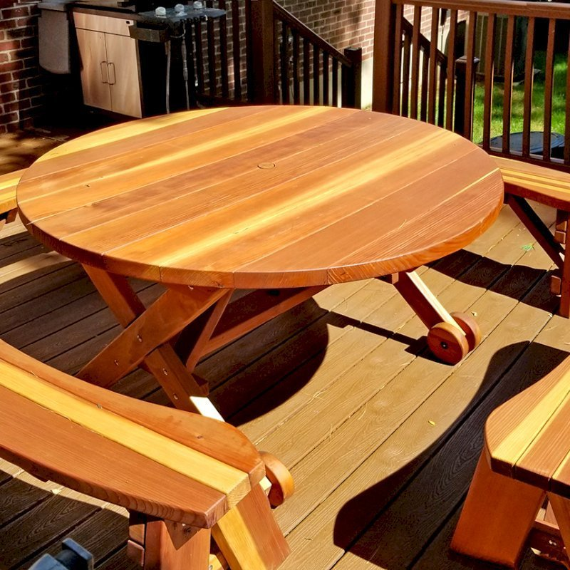 """Round Picnic Table with Wheels (Options: 5' diameter, Unattached Benches, Redwood, Round Picnic Benches, Standard Tabletop, No Lazy Susan, 1 5/8"""" Umbrella Hole & Plug, Transparent Premium Sealant). Photo Courtesy of A. Adler of Hempstead, New York."""