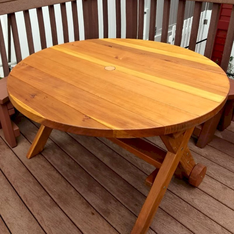"""Round Picnic Table with Wheels (Options: 4' Diameter, No Seating, Redwood, Standard Tabletop, No Lazy Susan, 2"""" Umbrella Hole, Transparent Premium Sealant). Photo Courtesy of L. Roberts of Hermosa Beach, CA."""