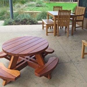 Toddler's Round Picnic Table (Mature Redwood, No Umbrella Hole, Standard Tabletop, No ADA, Transparent Premium Sealant). Photo Courtesy of J. Kunz of Portola Valley, CA. Note: pale, thin other wood furniture is not ours!!