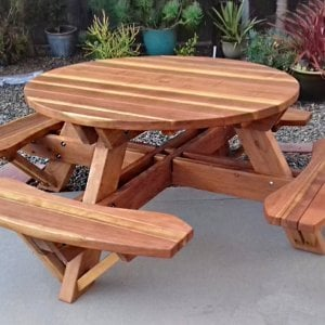 "Round Picnic Table (Options: 4.5' Diameter, Attached Benches, Redwood, Standard Tabletop, No Lazy Susan, 1 5/8"" Diameter Umbrella Hole & Plug, Transparent Premium Sealant). Photo Courtesy of B. Shushan of Carlsbad, CA."