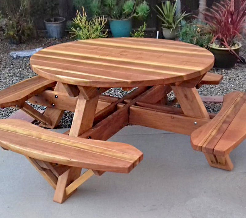 """Round Picnic Table (Options: 4.5' Diameter, Attached Benches, Redwood, Standard Tabletop, No Lazy Susan, 1 5/8"""" Diameter Umbrella Hole & Plug, Transparent Premium Sealant). Photo Courtesy of B. Shushan of Carlsbad, CA."""