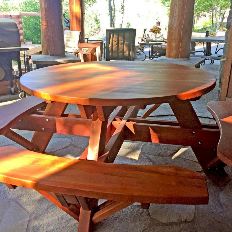 Round Picnic Table (Options: 5' Diameter, Attached Benches, Redwood, Seamless Tabletop, No Lazy Susan, No Umbrella Hole, Transparent Premium Sealant). Photo Courtesy of Brett Nann of Steamboat Springs, Colorado.