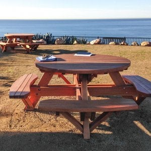 "Round Picnic Tables (Options: 4 1/2' Diameter, Attached Benches, Douglas-fir, Standard Tabletop, No Lazy Susan, 2"" Umbrella Hole & Plug, Transparent Premium Sealant). Photo Courtesy of Cynthia Hirschhorn of Pacific Palisades, CA."