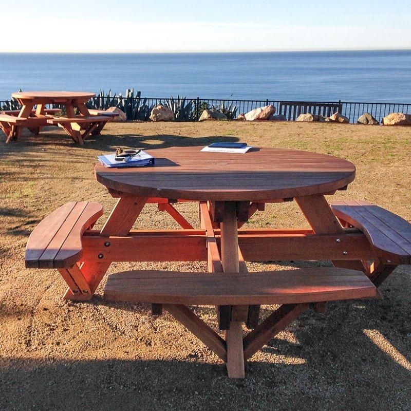 "Round Picnic Tables (Options: 4 1/2' Diameter, Attached Benches, Douglas-fir, Standard Tabletop, No Lazy Susan, 2"" Umbrella Hole & Plug, Transparent Premium Sealant). Photo Courtesy of Cynthia Hirschhorn of Pacific Palisades, CA."