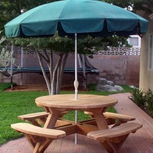 Round Picnic Table (Options: 4.5' Diameter, Attached Benches,  Mature Redwood, Standard Tabletop, No Lazy Susan, Umbrella Hole & Plug, Unfinished). We do not sell umbrellas, but we can drill an umbrella hole for you.