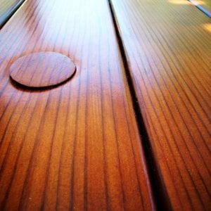 Closeup of tabletop highlighting the exquisite quality of the vertical grain lumber and the Transparent Premium Sealant - Mature Redwood.