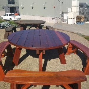 In 2017, the Hobbs Winery in Sebastopol called us to say that one of the two Old-Growth Redwood table sets they had purchased from us in 2003 had been damaged by a truck. We picked it up and rebuilt and refinished it. When we placed it next to the old table that is now 14 years, we got this picture that perfectly highlights how Redwood holds up over the decades without any maintenance. It just darkens as the table set in the rear shows, but it remains perfectly useable