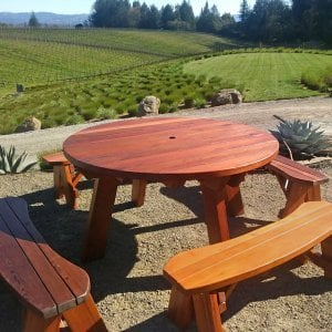 "Round Picnic Table (Options: 5' diameter, Unattached Benches, Redwood, Round Picnic Bench, Standard Tabletop, No Lazy Susan, 2"" Umbrella Hole, Transparent Premium Sealant). Photo Courtesy of C. Bailey of Sebastopol, CA."