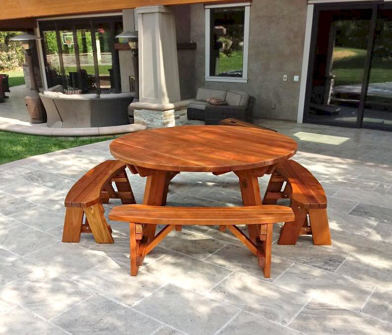 Round Picnic Table (Options: 5 1/2' Diameter, Unattached Benches, Redwood, Round Picnic Bench, Standard Tabletop, No Lazy Susan, No Umbrella Hole, Transparent Premium Sealant). Photo Courtesy of W. Jenkins of Orange, CA.