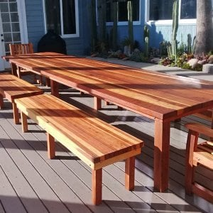 "San Francisco Patio Table (Options: 16' L, 48"" W Tabletop, Redwood, Side Benches & End Chairs, Classic Picnic Benches, Ruth Chairs, Standard Tabletop, Squared Corners, 2 Half Length Benches Per Side, No Umbrella Hole, Transparent Premium Sealant). Photo Courtesy of K. Butler of Malibu, CA."