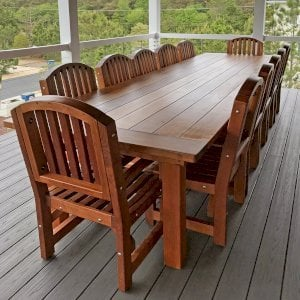 """San Francisco Patio Table (Options: 12' L, 48"""" W Tabletop, Chairs, Mature Redwood, 12 Chairs, Luna Chair Design, 2 Armchairs & Side Chairs, No Cushions, Old Country Tabletop, Standard , Slightly Rounded Corners, No Umbrella Hole, Transparent Premium Sealant). Photo Courtesy of John Eklund of Bethany Beach, Delaware."""