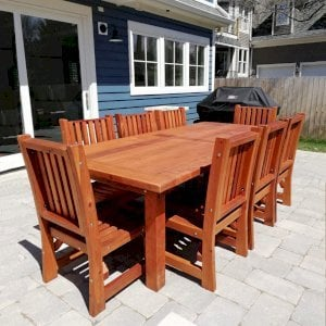 "San Francisco Patio Table (Options: 8' L, 48"" W Tabletop, Chairs, Mature Redwood, 8 Chairs, Ruth Chair Design, All Side Chairs, No Cushions, Old Country Tabletop, Standard, Slightly Rounded Corners, No Umbrella Hole, Transparent Premium Sealant). Photo Courtesy of K. Pickett of Naperville, Illinois."