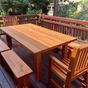 "San Francisco Patio Table (Options: 7' L, 46"" W, Benches & End Armchairs, Ruth Chairs, Trestle Benches, 2 Half Length Benches Per Side, Standard Tabletop, Slightly Rounded Corners, 1 5/8"" Diameter Umbrella Hole, Transparent Premium Sealant). Photo Courtesy of M. Colbruno of Oakland, CA."