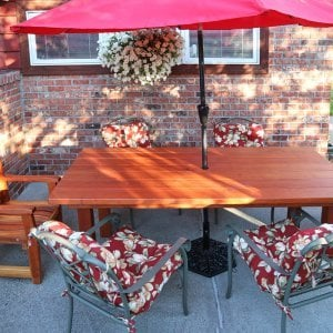 "San Francisco Patio Table (Options: 7' L, 40 1/4"" W Tabletop, Chairs, Redwood, 2 Chairs, Ruth Chair Design, All Armchairs, No Cushions, Standard Tabletop, Slightly Rounded Corners, 1 5/8"" Umbrella Hole, Transparent Premium Sealant). Photo Courtesy of W. Morlin of Spokane, Washington."