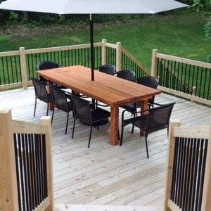 "San Francisco Patio Table (Options: 8' L, 40 1/4"" W Tabletop, No Seating [Photo Shows Customer's Chairs], Redwood, Standard Tabletop, Rounded Corners, Umbrella Hole [Umbrella not Included], Transparent Premium Sealant). Photo Courtesy of Douglas Rappley of Rockford, Michigan."