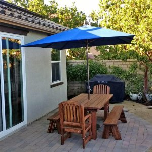 """San Francisco Patio Table (Options: 6' L, 40 1/4"""" W Tabletop, Douglas-fir, Side Benches & End Chairs, Luna Chairs, Classic Picnic Benches, Standard Tabletop, Square Corners, 1 5/8"""" Umbrella Hole, Coffee Stain Premium Sealant). Photo Courtesy of H. M. Via of Valencia, CA. Douglas-Fir when stained dark creates a """"tiger stripe"""" effect as shown in this photo. It is beautiful and most customers love it. If you are looking for a dark consistent stain, please go with Mature Redwood for the most consistent staining result."""