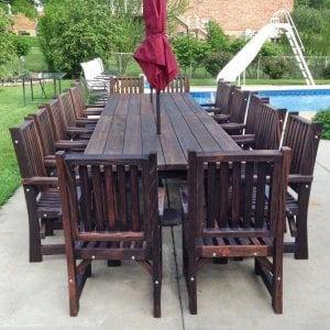 "2 San Francisco Patio Tables (Options: 7' L, 46"" W Tabletop, Chairs, Mature Redwood, 8 Chairs, Ruth Chair Design, All Arm Chairs, No Cushions, Standard Tabletop, Slightly Rounded Corners, Umbrella Hole, Coffee-Stain Premium Sealant). Photo Courtesy of Andy D. of Indianapolis Indiana."