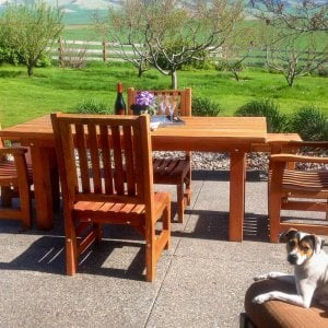 "San Francisco Patio Table (Options: 6' L, 46"" W Tabletop, Chairs, Mature Redwood, 4 Chairs, Ruth Chair Design, 2 Armchairs & Side Chairs, No Cushions, Standard Tabletop, Slightly Rounded Corners, No Umbrella Hole, Transparent Premium Sealant). Photo Courtesy of Martha Clinehens of Walla Walla, Washington."