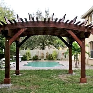 Sebastopol Pergola (Options: 14' L x 16' Arc W, California Redwood, 4-Post Anchor Kit for Hurricane-Wind, No Ceiling Fan Base, 9' H Posts, Coffee-Stain Premium Sealant). Photo Courtesy of T. Green of Boynton Beach, Florida.