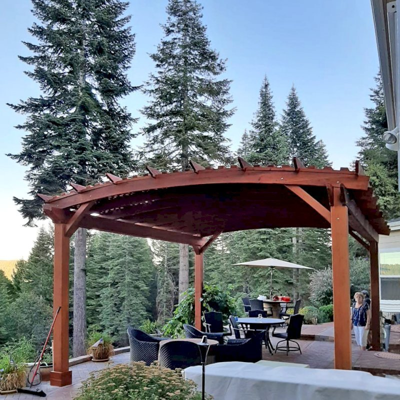 Custom Sebastopol Pergola (Options: 20' L x 18' Arc W, California Redwood, 4-Post Anchor Kit for Concrete, with Lattice Panels by Custom Request, No Ceiling Fan Base, 10' H Posts, Transparent Premium Sealant). Photo Courtesy of E. Greenwood of Nevada City, California.