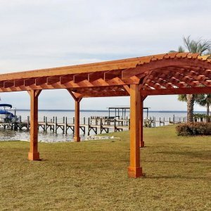 Sebastopol Pergolas (Options: 32' L x 24' Arc W, Redwood, 6-Post Anchor Kit for Hurricane, No Ceiling Fan Base, Transparent Premium Sealant). Photo Courtesy of J. Graves of Santa Rosa Beach, Florida.
