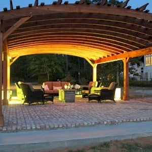 Sebastopol Pergolas (Options: 32' L x 24' Arc W, California Redwood, 6-Post Anchor Kit for Hurricane, No Ceiling Fan Base, Transparent Premium Sealant). Photo Courtesy of J. Graves of Santa Rosa Beach, Florida.